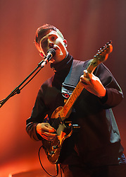 © Licensed to London News Pictures. 01/12/2014. London, UK.   The Maccabees performing live at Brixton Academy, supporting headliner Kasabian.  In this picture - Orlando Weeks. The Maccabees are an indie rock band consisting of members Orlando Weeks (vocals), Hugo White (guitars, Felix White (guitars, backing vocals), Rupert Jarvis (bass), Sam Doyle (drums), Will White (keyboards).  Photo credit : Richard Isaac/LNP