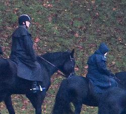 © Licensed to London News Pictures. 22/11/2019. Windsor, UK. Prince Andrew, The Duke of York  (left), is seen riding a horse with Queen Elizabeth II (right) in the grounds of Windsor Castle estate. Prince Andrew is stepping down from official duties following a Newsnight interview on his relationship with Jeffrey Epstein. Photo credit: Ben Cawthra/LNP