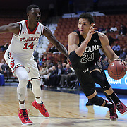 Michael Carrera, (right), South Carolina, drives past Kassoum Yakwe, St. John's, during the St. John's vs South Carolina Men's College Basketball game in the Hall of Fame Shootout Tournament at Mohegan Sun Arena, Uncasville, Connecticut, USA. 22nd December 2015. Photo Tim Clayton
