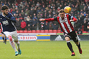 Billy Sharp of Sheffield United (10) gets away from Tobias Pereira Figueiredo of Nottingham Forest (3) during the EFL Sky Bet Championship match between Sheffield United and Nottingham Forest at Bramall Lane, Sheffield, England on 17 March 2018. Picture by Mick Haynes.
