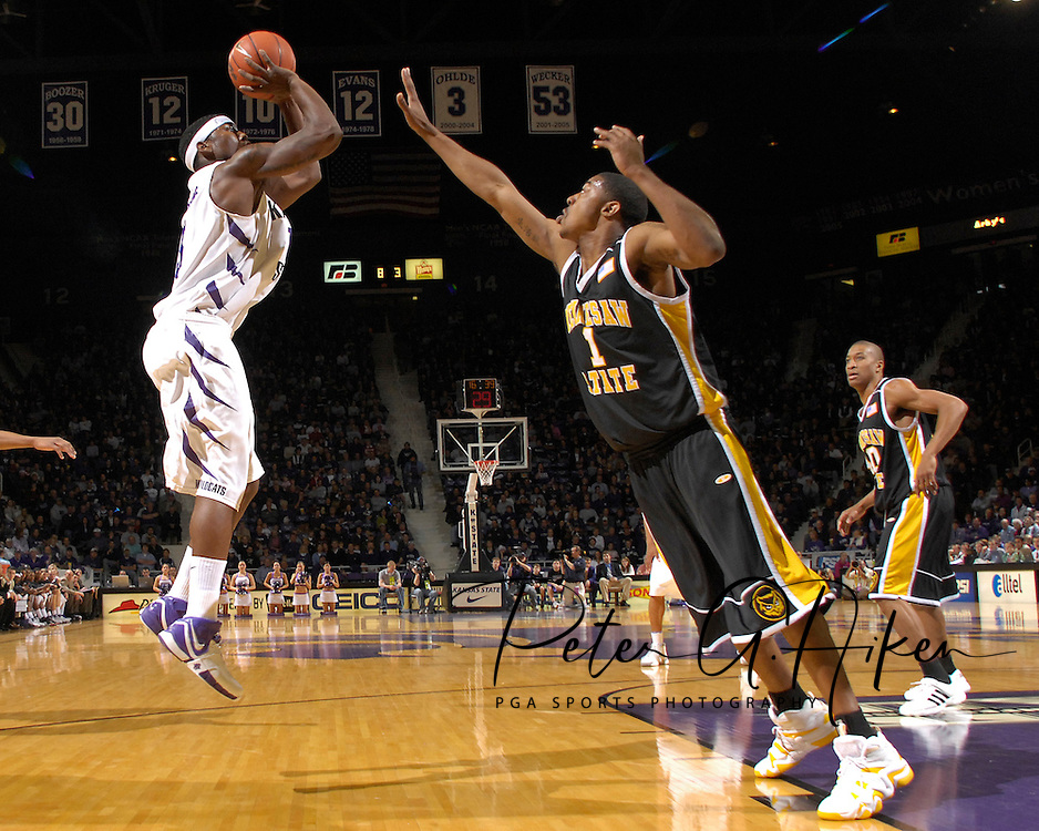 Kansas State forward David Hoskins (L) scores over Kennesaw State forward Shuan Stegall (R) in the first half at Bramlage Coliseum in Manhattan, Kansas, December 17, 2006.  Hoskins lead all scorers with 17 points.  K-State beat Kennesaw State 82-54.<br />