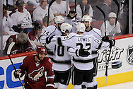 May 13, 2012; Glendale, AZ, USA; Los Angeles Kings left wing Dwight King (74)  , center Mike Richards (10) , center Trevor Lewis (22) and defenseman Willie Mitchell (33) celebrate after scoring a goal as Phoenix Coyotes defenseman Michal Rozsival (32) walks by in the second period of game one of the Western Conference finals of the 2012 Stanley Cup Playoffs at Jobing.com Arena.  Mandatory Credit: Jennifer Stewart-US PRESSWIRE.