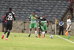 Justin Shonga of Orlando Pirates battle for the ball with Deon Hotto of Bloemfontein Celtic during the<br />