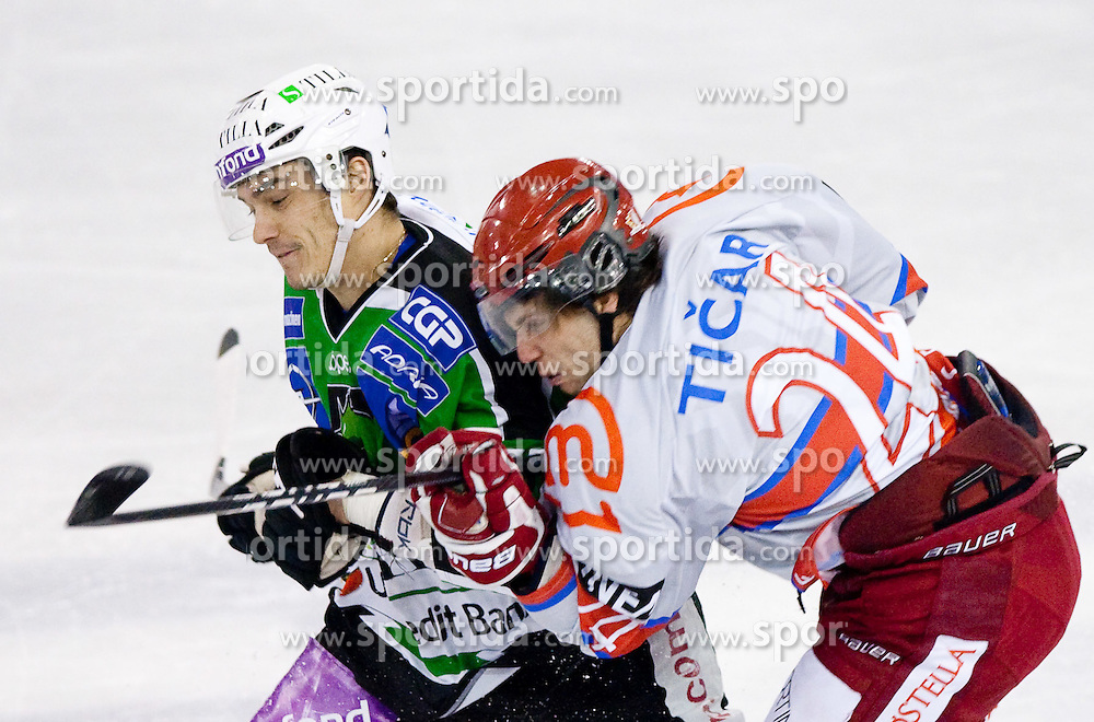 Ziga Pavlin of Olimpija vs Rok Ticar of Jesenice during ice-hockey match between HDD Tilia Olimpija and HK Acroni Jesenice in 26th Round of EBEL league, on December 10, 2010 at Hala Tivoli, Ljubljana, Slovenia.(Photo By Vid Ponikvar / Sportida.com)
