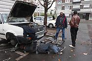 France, La Courneuve , cite of 4000.  Oudo is repairing cars in the cite, it s the underground economy  /La Courneuve, cite des 4000 , Oudo, le garagiste independant est camerounais et repare les voitures sur place,  /