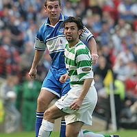 St Johnstone v Celtic...Scottish Cup Semi-Final...14.04.07<br /> Peter MacDonald chips the ball over Paul Hartley<br /> <br /> Picture by Graeme Hart.<br /> Copyright Perthshire Picture Agency<br /> Tel: 01738 623350  Mobile: 07990 594431