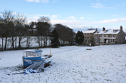 © Licensed to London News Pictures. <br /> 29/01/2015. <br /> <br /> Danby, United Kingdom<br /> <br /> A fishing boat sits in a field in Danby in North Yorkshire following overnight snow. A wintery blast causing extremely cold weather is expected to cause some disruption over the next few days.<br /> <br /> Photo credit : Ian Forsyth/LNP