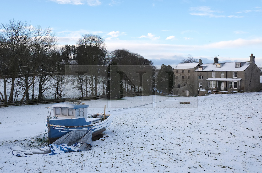 &copy; Licensed to London News Pictures. <br /> 29/01/2015. <br /> <br /> Danby, United Kingdom<br /> <br /> A fishing boat sits in a field in Danby in North Yorkshire following overnight snow. A wintery blast causing extremely cold weather is expected to cause some disruption over the next few days.<br /> <br /> Photo credit : Ian Forsyth/LNP