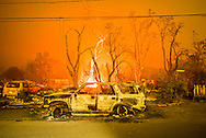 A burned out truck sits in front of a destroyed structure in Middletown, CA Sunday evening. <br /> <br /> <br /> Valley Fire in Lake and Sonoma Counties Sunday September 13th, 2015. As of Sunday evening the fire had burned over 50,000 acres and was 0% contained. The Associated Press reported that at least one person was killed due to the fire.