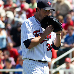 March 13, 2011; Fort Myers, FL, USA; Minnesota Twins relief pitcher Joe Nathan (36) exits the game after giving up six runs in one inning of play during a spring training exhibition game against the Philadelphia Phillies at Hammond Stadium.   Mandatory Credit: Derick E. Hingle