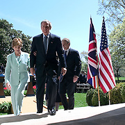 Pres. Bush and British Prime Minister Tony Blair hold a joint press availability in the Rose Garden of the White House Friday, April 16, 2004.  Bush and Blair discussed the ongoing situation in Iraq.   Also attending is First Lady Laura Bush...Photo by Khue Bui