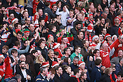 Middlesbrough fans celebrate during the Sky Bet Championship match between Brighton and Hove Albion and Middlesbrough at the American Express Community Stadium, Brighton and Hove, England on 19 December 2015. Photo by Bennett Dean.