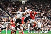 Derby County striker David Nugent (28), Derby County defender Richard Keogh (6) and Nottingham Forest defender Danny Fox (13) battle in the air during the EFL Sky Bet Championship match between Derby County and Nottingham Forest at the Pride Park, Derby, England on 15 October 2017. Photo by Jon Hobley.