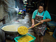 "07 FEBRUARY 2018 - BANGKOK, THAILAND: A woman in Bangkok's ""Chinatown""  prepares mung beans for desserts consumed during Lunar New Year celebrations. The Lunar New Year, also called Tet or Chinese New Year, is 16 February this year. The coming year will be the Year of the Dog. Thailand has a large Chinese community and Lunar New Year is widely celebrated in Thailand, especially in Bangkok and large cities with significant Chinese communities.      PHOTO BY JACK KURTZ"