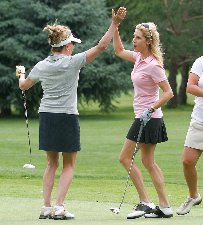 Wendy DiVenere celebrates a birdie with Caryl Cherry at the Aspen Golf Club.