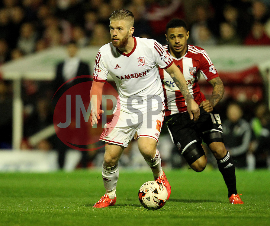 Middlesbrough's Adam Clayton is chased down by Brentford's Andre Gray - Photo mandatory by-line: Robbie Stephenson/JMP - Mobile: 07966 386802 - 08/05/2015 - SPORT - Football - Brentford - Griffin Park - Brentford v Middlesbrough - Sky Bet Championship