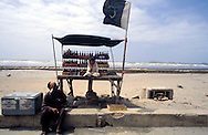 Pakistan  Karachi 1986..A kiosk of drinks a Clifton Beach with the flag of the Pakistan