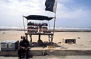 Pakistan  Karachi 1986..A kiosk of drinks a Clifton Beach with the flag of the Pakistan