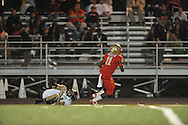 Lafayette High's Rashun Rockette (11) scores vs. New Albany's Jacob Hall (34) on Homecoming in Oxford, Miss. on Friday, October 18, 2013.
