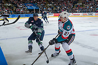 KELOWNA, CANADA - APRIL 26: Alexander True #16 of the Seattle Thunderbirds passes the puck past Calvin Thurkauf #27 of the Kelowna Rockets in front of the boards during first period on April 26, 2017 at Prospera Place in Kelowna, British Columbia, Canada.  (Photo by Marissa Baecker/Shoot the Breeze)  *** Local Caption ***