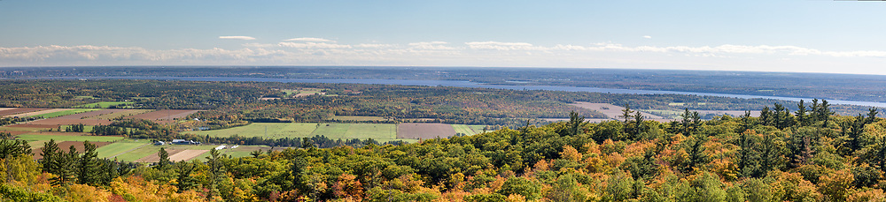 View of Quebec, the Ottawa River, and Ontario from the Huron Lookout. Photographed from the Huron Lookout at Gatineau Park in Chelsea, Québec, Canada. The Huron Lookout is located on the edge of the Eardley Escarpment which is the dividing line between the Canadian Shield and the St. Lawrence Lowlands.