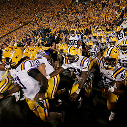 Oct 10, 2009; Baton Rouge, LA, USA;  LSU Tigers players run onto the field before the start of their game against the Florida Gators at Tiger Stadium. Florida defeated LSU 13-3. Mandatory Credit: Derick E. Hingle-US PRESSWIRE