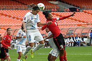 20 October 2014: Maria Monterroso (GUA) (8) heads the ball over Maylee Attin (TRI) (9). The Trinidad & Tobago Women's National Team played the Guatemala Women's National Team at RFK Memorial Stadium in Washington, DC in a 2014 CONCACAF Women's Championship Group A game, which serves as a qualifying tournament for the 2015 FIFA Women's World Cup in Canada. Trinidad and Tobago won the game 2-1 to secure advancement to the semifinals.