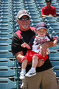 ANAHEIM, CA - MAY 14:  A Boston Red Sox fan and his son pose for a photo before the game against the Los Angeles Angels of Anaheim at Angel Stadium in Anaheim, California on Thursday, May 14, 2009.  The Angels defeated the Red Sox 5-4 in 12 innings.  (Photo by Paul Spinelli/MLB Photos)