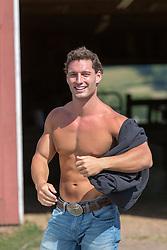 hunky man taking off his shirt