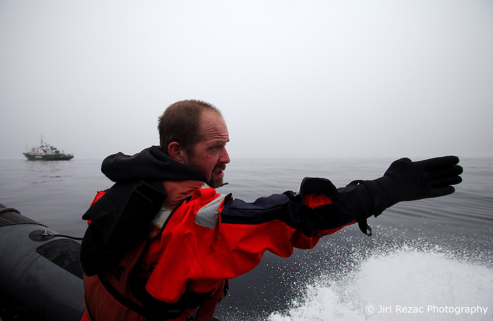 LABRADOR SEA 16JUN11 - Third mate Kevin Bell of the USA during boat training from aboard the Greenpeace ship Esperanza in the Davis Stait off the coast of Greenland.....Photo by Jiri Rezac / Greenpeace