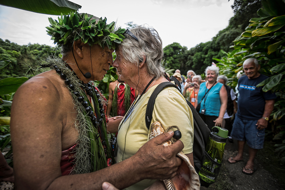 Molokai Museum Road Scholars get a lesson in how to do the traditional Hawaiian greeting of the honi from Anakala Pilipo Solatorio. The honi is done by touching nose-to-nose and inhaling or essentially sharing each other's breaths. ©PF Bentley