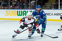 KELOWNA, BC - SEPTEMBER 29:  Sam Gagner #89 of the Vancouver Canucks checks Jordan Oesterle #82 of the Arizona Coyotes during third period at Prospera Place on September 29, 2018 in Kelowna, Canada. (Photo by Marissa Baecker/NHLI via Getty Images)  *** Local Caption *** Jordan Oesterle; Sam Gagner