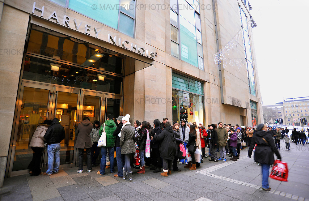 EDINBURGH, UK: 26th December 2009 - A record number people are expected to hit the high street on Boxing Day as the date falls on a Saturday for the first time in more than a decade. Pictured shoppers queue outside Edinburgh's Harvey Nicols to take advantage of the sales with the store offering designer handbags and shoes at discounts of up to fifty percent. (Photograph: Callum Bennetts/MAVERICK)