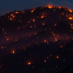 Several small fires remain on the backside of Scratchgravel Hills in Helena, Montana. The fire erupted on June 25, 2012 and quickly spread to over 3000 acres.