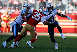 SANTA CLARA, CA - DECEMBER 17: Wide receiver Taywan Taylor #13 of the Tennessee Titans is tackled by strong safety Eric Reid #35 of the San Francisco 49ers during the first quarter at Levi's Stadium on December 17, 2017 in Santa Clara, California.  (Photo by Jason O. Watson/Getty Images) *** Local Caption *** Taywan Taylor; Eric Reid