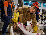 07 JUNE 2018 - SEOUL, SOUTH KOREA:  A porter packs a ray sold at auction in the Noryangjin Fish Market. The auctions start about 01.00 AM and last until 05.00 AM. Noryangjin Fish Market is the largest fish market in Seoul and has been in operation since 1927. It opened in the current location in 1971 and was renovated in 2015. The market serves both retail and wholesale customers and has become a tourist attraction in recent years.     PHOTO BY JACK KURTZ