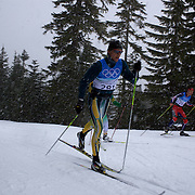 Winter Olympics, Vancouver, 2010.Australian Ben Sim training in the snow on the Olympic Cross Country course at  Whistler Olympic Park  in preparation for the event at the Winter Olympics. 10th February 2010. Photo Tim Clayton