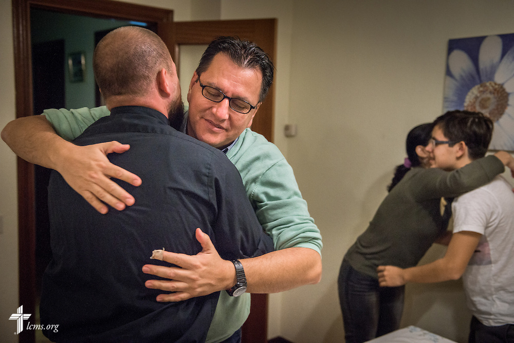 Jose Antonio hugs the Rev. Adam Lehman, LCMS career missionary to Spain, during home worship led by the Rev. David Warner, fellow LCMS career missionary, at the family's home Friday, Nov. 4, 2016, in Valladolid, Spain. LCMS Communications/Erik M. Lunsford