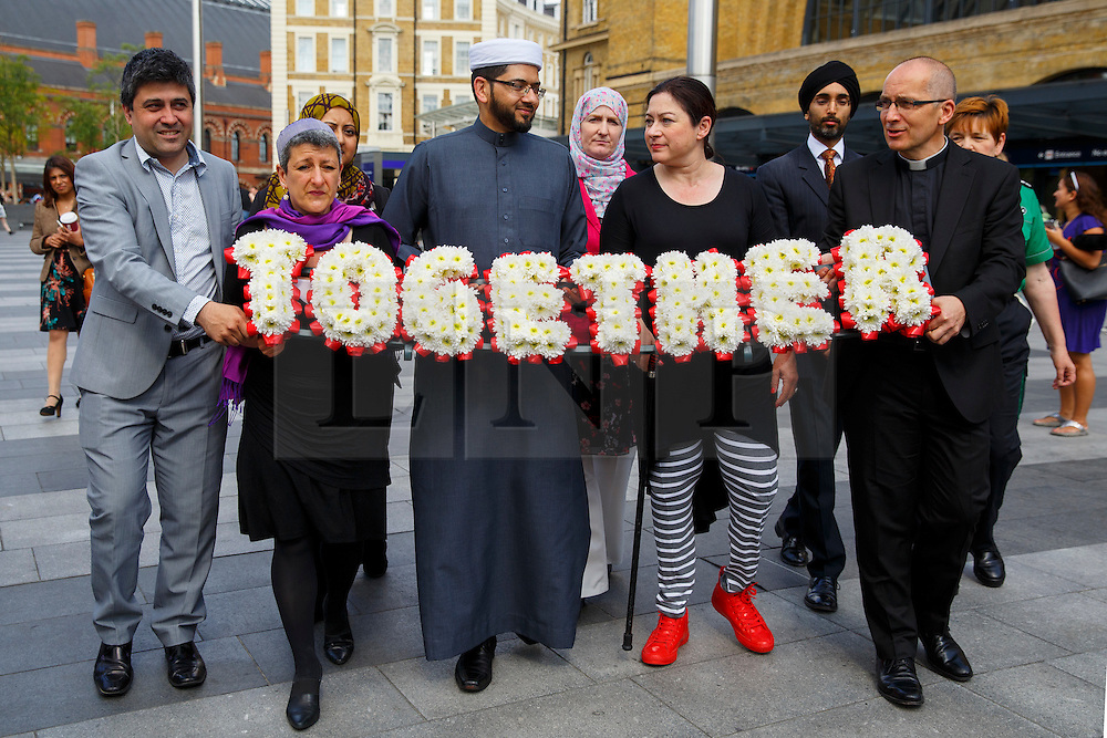 © Licensed to London News Pictures. 06/07/2015. London, UK. 7/7 survivor Gill Hicks walk with faith leaders: Rabbi Laura Janner-Klausner, Imam Qari Asim and Revd Bertrand Olivier from King's Cross station to Tavistock Square in a quiet moment of solidarity and reflection to commemorate the 10th anniversary of 7/7 bombings by remembering those who lost their lives, as well as offering a message of peace and unity between people of different faiths and backgrounds. Photo credit: Tolga Akmen/LNP