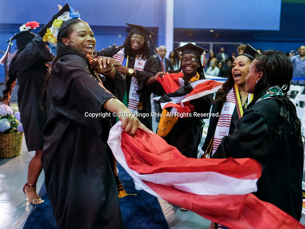 RIVERSIDE, CA - JUNE 11, 2017: Graduates dance during the Black Graduation Ceremony at University of California, Riverside, Sunday June 11, 2017. (Photo by Ringo H.W. Chiu / For The Times)(Photo by Ringo Chiu)<br /> <br /> Usage Notes: This content is intended for editorial use only. For other uses, additional clearances may be required.
