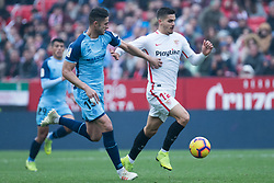 December 16, 2018 - Seville, Andalucia, Spain - Andre Silva of Sevilla Fc and Juanpe of Girona competes for the ball during the LaLiga match between Sevilla FC and Girona at Estadio Ramón Sánchez Pizjuán on December 16, 2018 in Seville, Spain  (Credit Image: © Javier MontañO/Pacific Press via ZUMA Wire)
