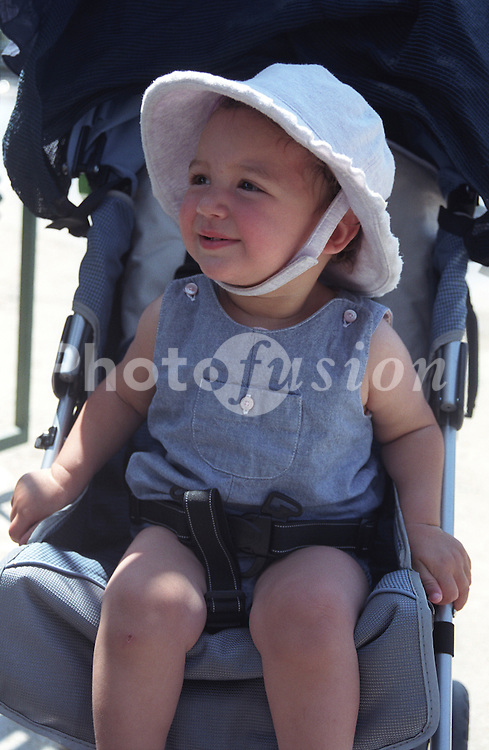 Toddler girl sitting in buggy