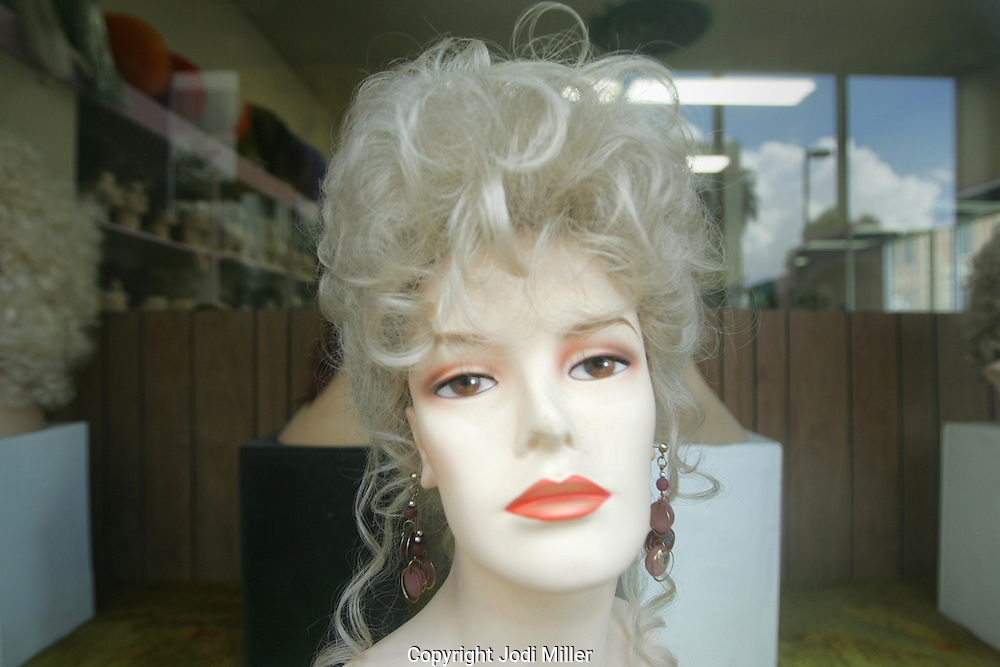 A wig in a wndow.