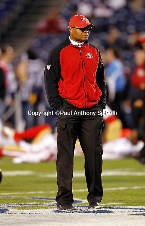San Francisco 49ers head coach Mike Singletary watches pregame warmups during the NFL week 15 football game against the San Diego Chargers on Thursday, December 16, 2010 in San Diego, California. The Chargers won the game 34-7. (©Paul Anthony Spinelli)