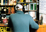 A man listening to music on headphones, Catapult Records in Cardiff, 2002