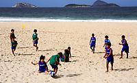 brazilian kids palying soccer on ipanema beach in rio de janeiro brazil