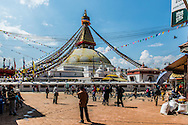 A man stands looking at the giant stupa at Boudhanath. The ancient Stupa is one of the largest in the world and now a major tourist attraction after being declared a UNESCO World Heritage Site in 1979.