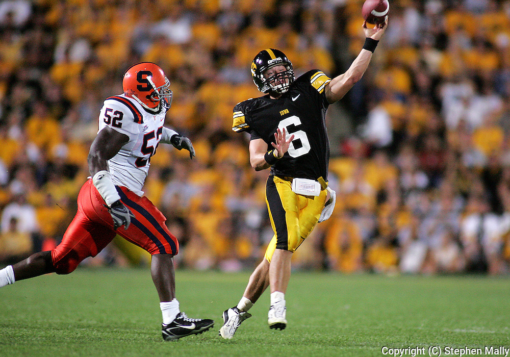 08 SEPTEMBER 2007: Iowa quarterback Jake Christensen (6) throws while being chased by Syracuse defensive end Jamell McClain (52) in Iowa's 35-0 win over Syracuse at Kinnick Stadium in Iowa City, Iowa on September 8, 2007.