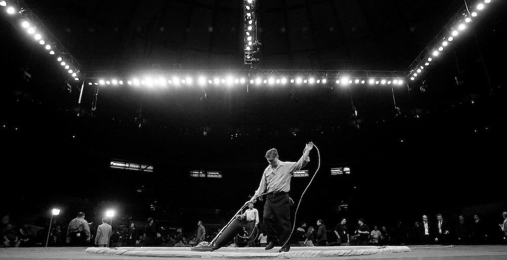 A worker vacuums the ring before the World Sumo Challenge at New York's Madison Square Garden Saturday 22 October 2005.