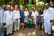 30-5-2018 - MUMBIA - Queen Maxima of the Netherlands holds a tiffin as she poses with Dabbawalas they got a digital banking account, also known as tiffin carriers, during their meeting in Mumbai, India. Queen Maxima during a visit to India. Maxima visits the country at the invitation of the government and in her capacity as special advocate of the Secretary-General of the United Nations for inclusive financing for development.  COPYRIGHT ROBIN UTRECHT